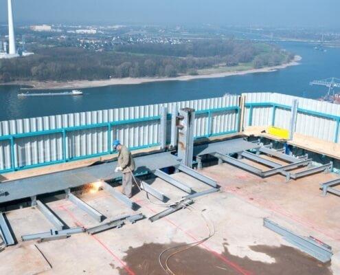 w1-bayer-hochhaus-optimale-arbeitsbedingungen-absturzsicherung-staubschutz-laermschutz-durch-intelligente-demontagetechnologie